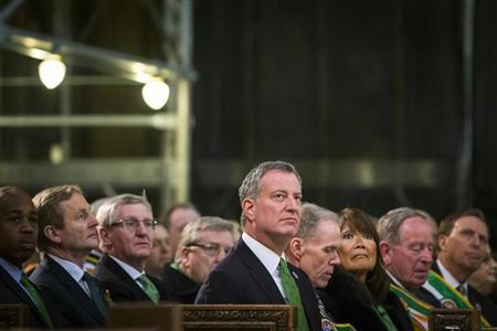 New York Mayor Bill de Blasio listens to a service at Saint Patrick's Cathedral in New York