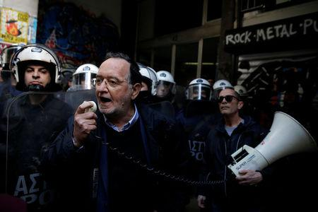 Leader of Popular Unity Party Panagiotis Lafazanis shouts slogans through a loudspeaker during a protest against home auctions in Athens, Greece, March 14, 2018. REUTERS/Costas Baltas