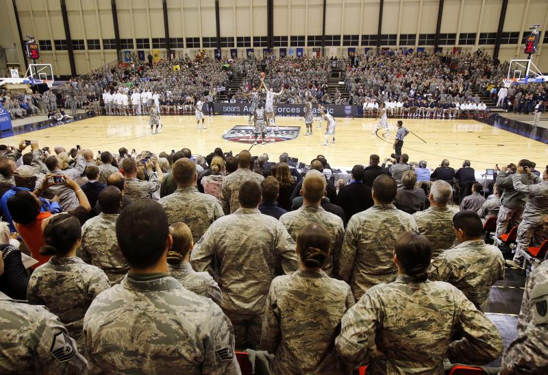 U.S. Army service members watch an NCAA men's basketball game between Michigan State and Connecticut on Saturday, Nov. 10, 2012, on the Ramstein U.S. Air Force Base, in Ramstein, Germany. (AP Photo/Michael Probst)