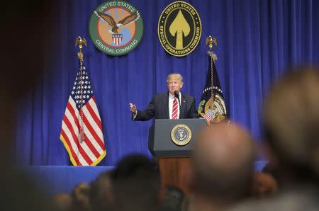 U.S. President Donald Trump is welcomed as he speaks to commanders and coalition representatives during a visit to U.S. Central Command and U.S. Special Operations Command at MacDill Air Force Base in Tampa, Florida, U.S., February 6, 2017.   REUTERS/Carlos Barria