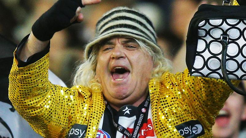 Joffa Corfe, pictured at a Collingwood AFL game, has threatened to boycott the league.