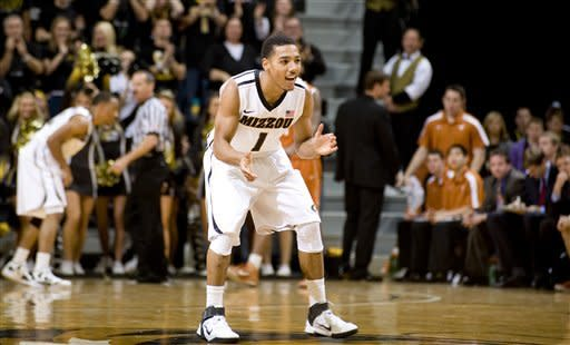 Missouri's Phil Pressey, center, celebrates after he scoring during the second half of an NCAA college basketball game against Texas Saturday, Jan. 14, 2012, in Columbia, Mo. Missouri won the game 84-73. (AP Photo/L.G. Patterson)