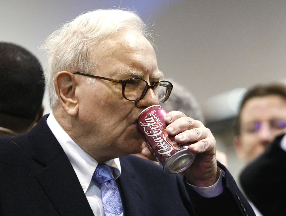 Berkshire Hathaway chairman Warren Buffett drinks a can of Cherry Coke at the Berkshire Hathaway annual meeting in Omaha May 1, 2010. Berkshire Hathaway owns about 8.7 % of Coca-Cola Co.    REUTERS/Rick Wilking (UNITED STATES - Tags: BUSINESS)