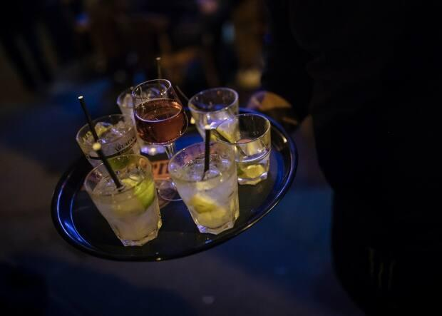 By ordering an 'Angelot,' which means little angel in French, a bar patron can secretly ask for help if they are feeling unsafe and be escorted to a safe place. (AP Photo/Lewis Joly - image credit)
