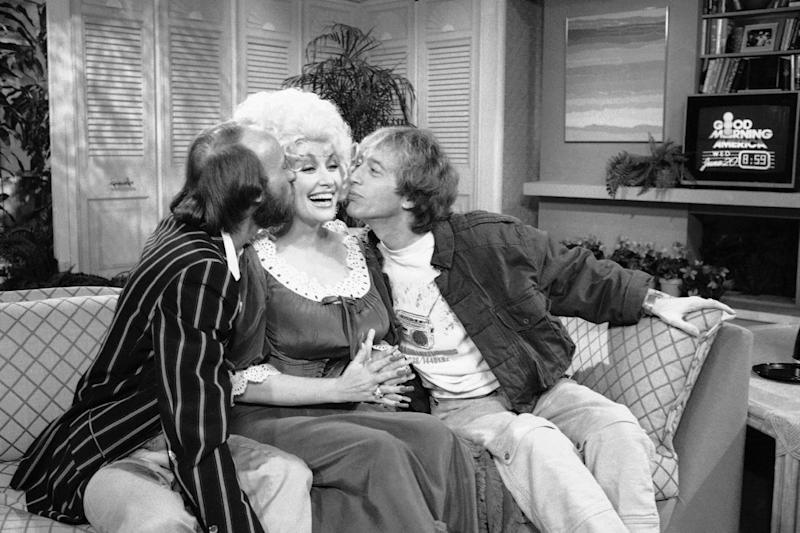 """This June 20, 1984, file photo, shows from left, Morris Gibb, Dolly Parton, and Robin Gibb, on ABC-TV's """"Good Morning America Show"""" in New York. A representative said on Sunday, May 20, 2012, that Robin Gibb has died at the age of 62. (AP Photo/Mario Suraini)"""