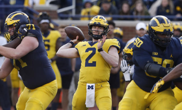 FILE- In an April 13, 2019, file photo, Michigan quarterback Shea Patterson (2) throws during the team's annual spring NCAA college football game in Ann Arbor, Mich. Patterson returns for a second season after transferring from Mississippi. The dual-threat standout will play behind four returning starters in a new-look offense featuring a trio of talented receivers. (AP Photo/Carlos Osorio, File)