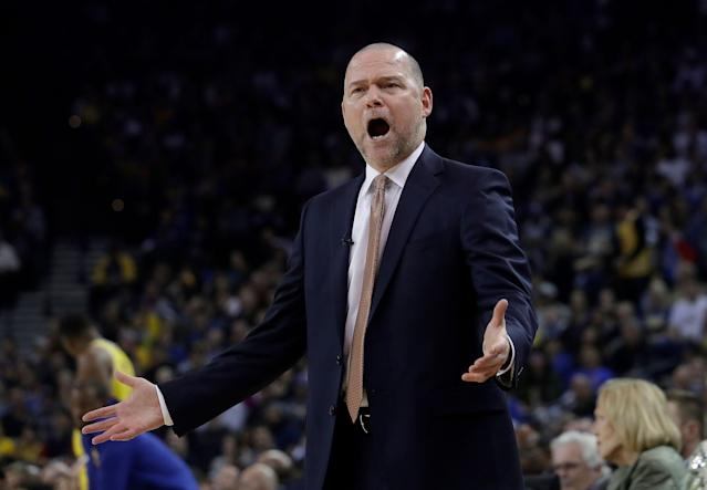 Denver Nuggets head coach Michael Malone yells during the first half of an NBA basketball game against the Golden State Warriors in Oakland, Calif., Tuesday, April 2, 2019. (AP Photo/Jeff Chiu)