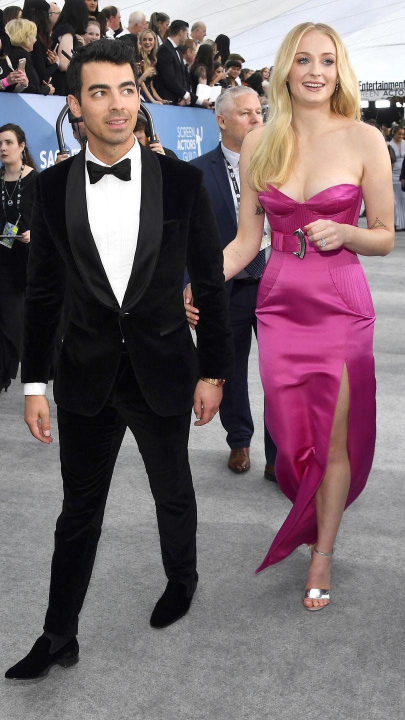 <p>The couple looked divine at their first show of awards season 2020. Sophie Turner wore a hot pink dress by Louis Vuitton and Joe Jonas looked dapper in a tuxedo with a bow tie.</p>