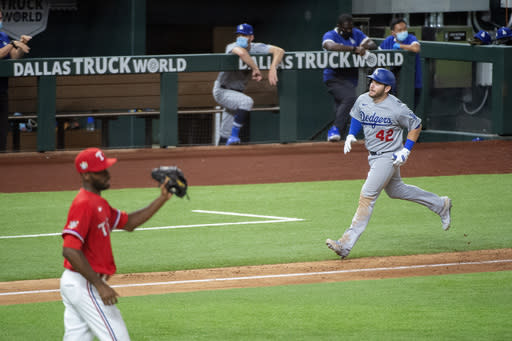 Muncy 4 RBIs for Dodgers in 7-4 win over Rangers and Lynn