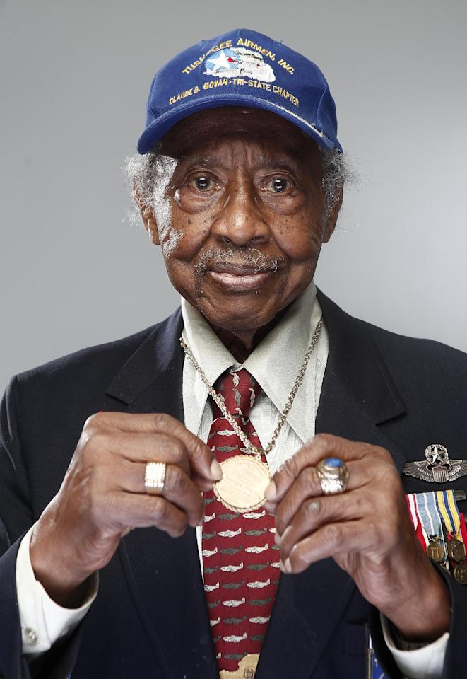 "In this Jan. 10, 2012 photo, Tuskegee airman Floyd Carter Sr. poses for a portrait during the ""Red Tails"" press junket in New York. ""Red Tails,"" a film that chronicles the heroism of the Tuskegee Airmen, opens Friday, Jan. 20. (AP Photo/Carlo Allegri)"