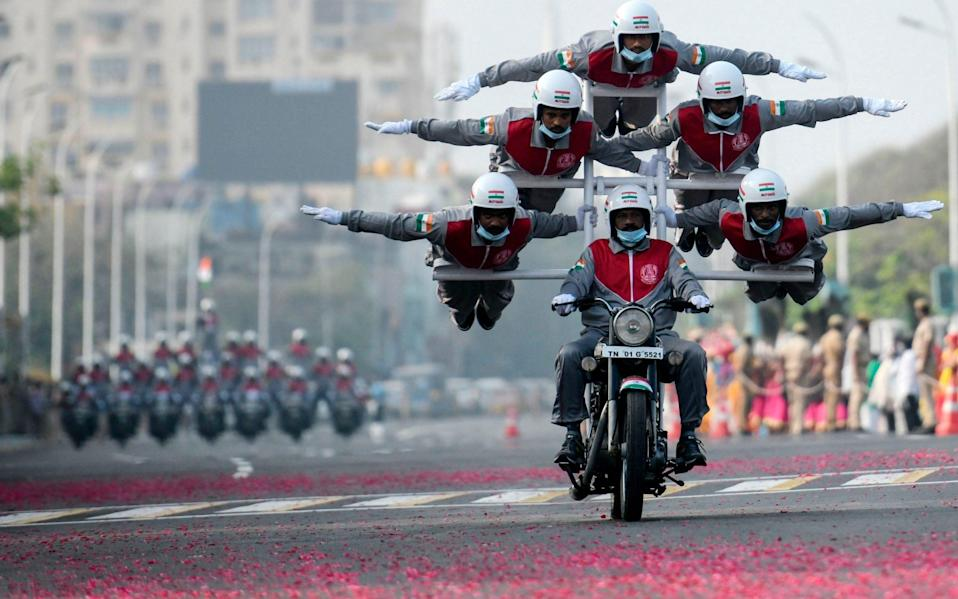 Cadets of Tamilnadu Police perform an acrobatic stunt during a full dress rehearsal for the upcoming Republic Day Parade in Chennai