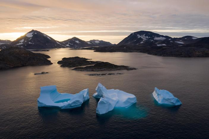 In this Aug. 16, 2019 file photo, icebergs float away as the sun rises near Kulusuk, Greenland. According to a study released on Thursday, Aug. 20, 2020, Greenland lost a record amount of ice during an extra warm 2019, with the melt massive enough to cover California in more than four feet of water.