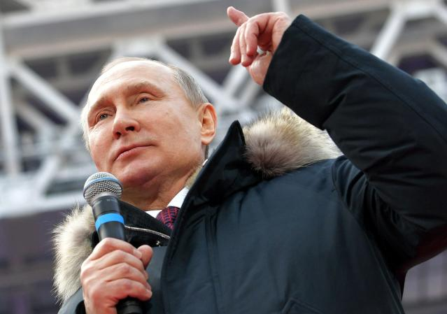 <p>Russian President Vladimir Putin gestures while speaking during a massive rally in his support as a presidential candidate at the Luzhniki stadium in Moscow, Russia, Saturday, March 3, 2018. (Photo: Alexei Druzhinin, Sputnik/Kremlin Pool Photo via AP) </p>
