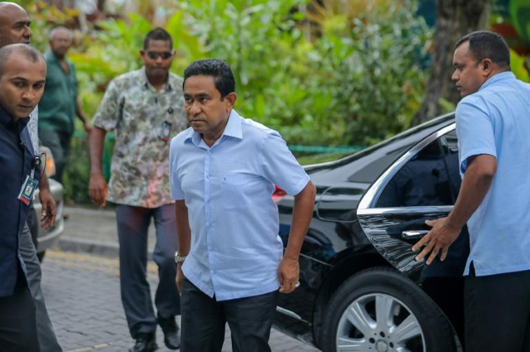 It was far from certain if Maldives President Abdulla Yameen (C), whose main political rivals were either jailed or in exile, would graciously accept defeat in the poll