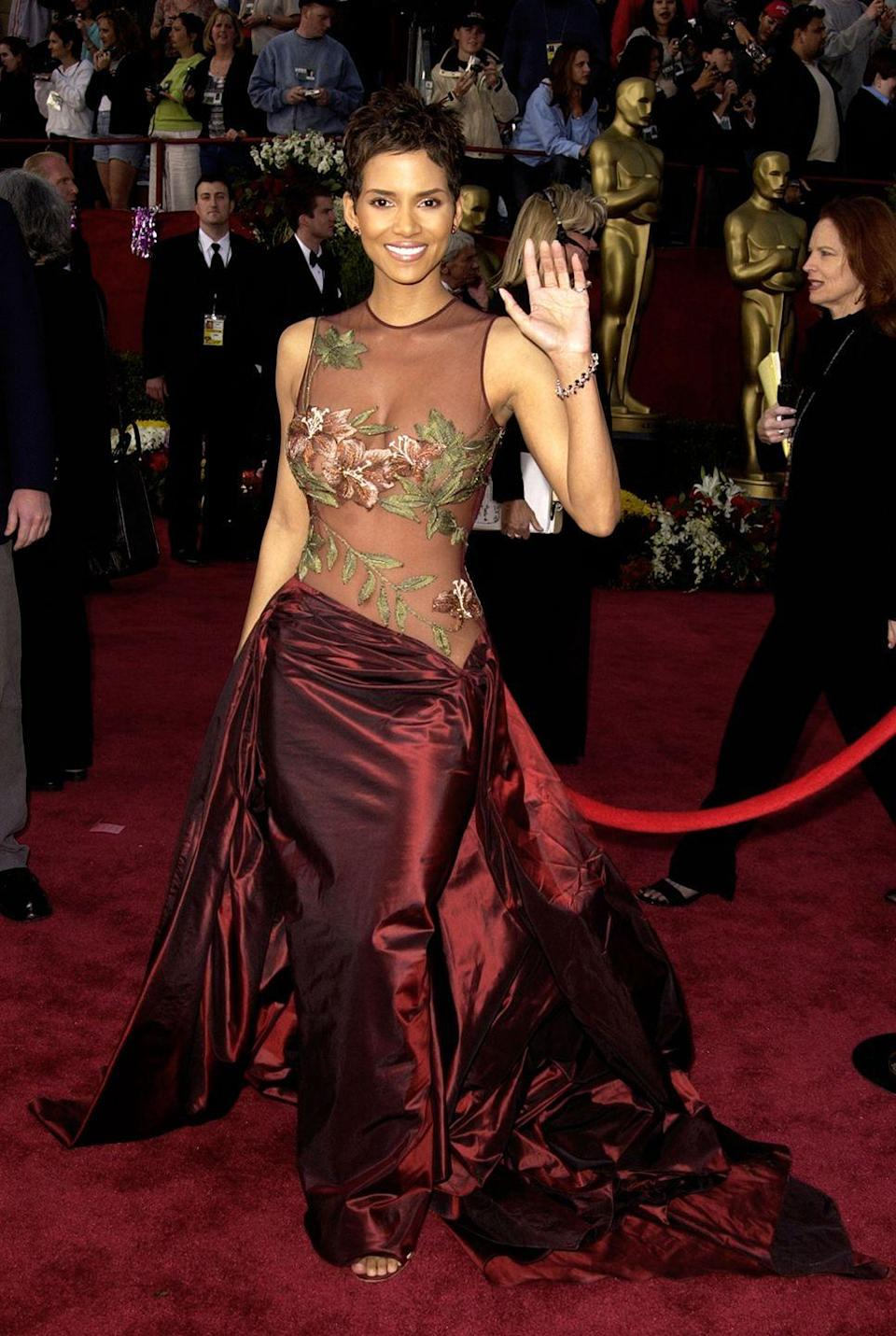<p>You can't think of the 2002 Academy Awards without also envisioning this Elie Saab dress on Halle Berry. It remains one of the actress's most iconic looks of all time thanks to the completely see-through bodice and the strategically-placed floral embroidery. </p>