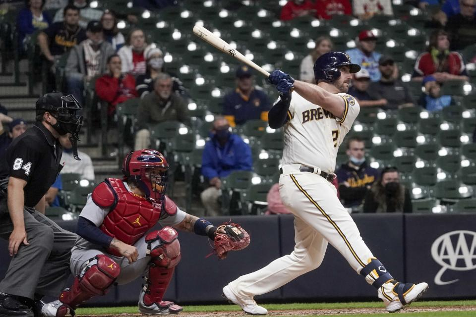 Milwaukee Brewers' Travis Shaw hits an RBI double during the eighth inning of a baseball game against the St. Louis Cardinals Wednesday, May 12, 2021, in Milwaukee. (AP Photo/Morry Gash)