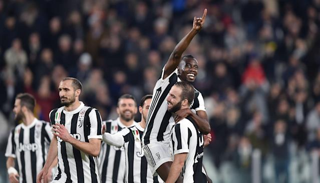 Juventus' Blaise Matuidi, top, celebrates with his teammate Gonzalo Higuain, right, after scoring his team's second goal during the Italian Serie A soccer match between Juventus and Atalanta at the Allianz Stadium in Turin, Italy, Wednesday, March 14, 2018. (Alessandro Di Marco/ANSA via AP)