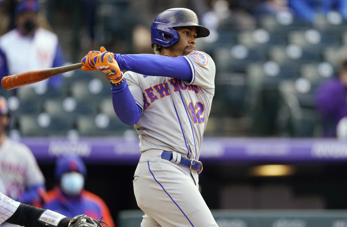 New York Mets' Francisco Lindor watches his single that drove in the go-ahead run off Colorado Rockies relief pitcher Daniel Bard during the seventh inning of a baseball game Saturday, April 17, 2021, in Denver. The Mets won 4-3 in the first game of a doubleheader. (AP Photo/David Zalubowski)