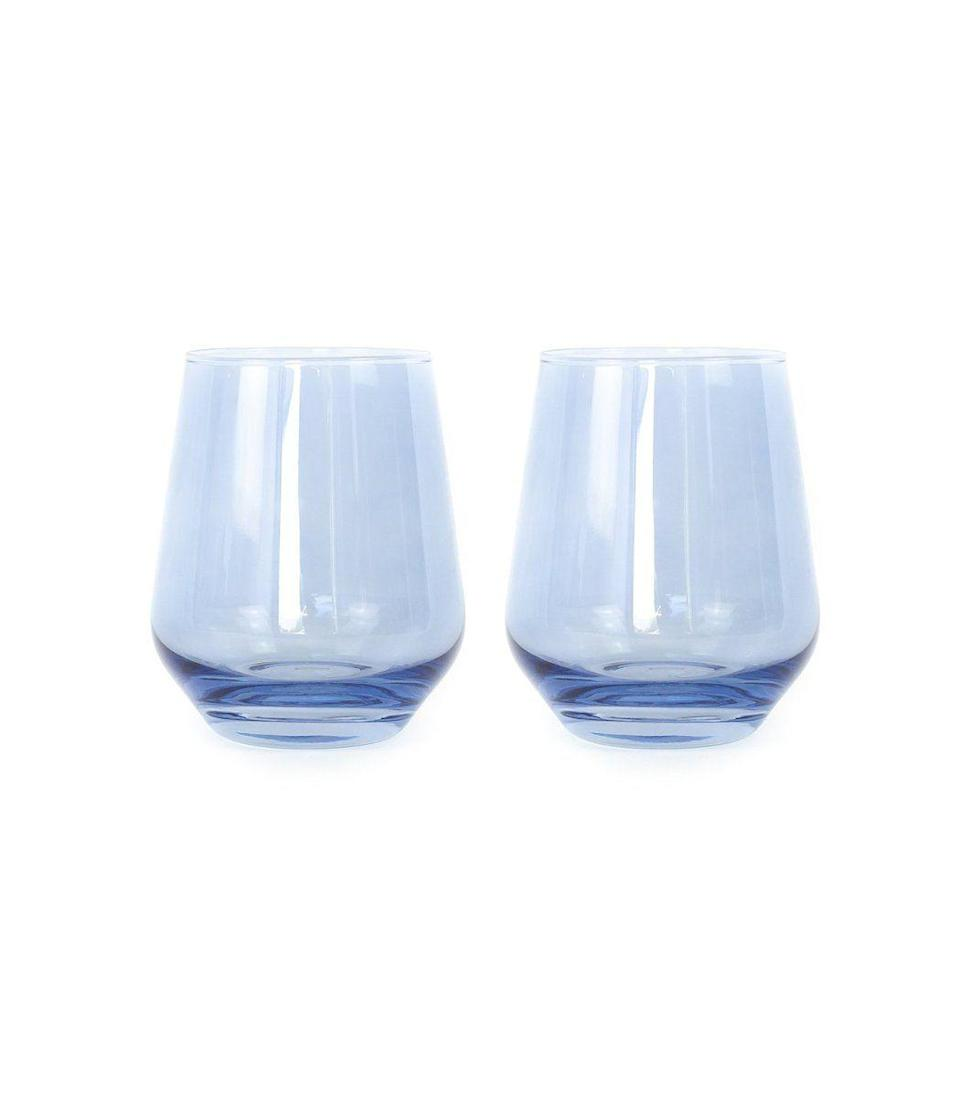 """<p><strong>Estelle Colored Glass</strong></p><p>ShopBAZAAR.com</p><p><strong>$65.00</strong></p><p><a href=""""https://go.redirectingat.com?id=74968X1596630&url=https%3A%2F%2Fshop.harpersbazaar.com%2Fdesigners%2Festelle-colored-glass%2Fcolored-stemless-wine-glasses-in-cobalt-blue-set-of-2-61253.html&sref=https%3A%2F%2Fwww.harpersbazaar.com%2Ffashion%2Fg31944159%2Fmothers-day-gifts-from-daughters%2F"""" rel=""""nofollow noopener"""" target=""""_blank"""" data-ylk=""""slk:Shop Now"""" class=""""link rapid-noclick-resp"""">Shop Now</a></p><p>The best gifts are also the ones you're prompted to use immediately. And as soon as she opens this set of two sippers, she'll want to pour herself a glass. Further, this hand-blown glassware will a special touch to any dinner party.</p>"""
