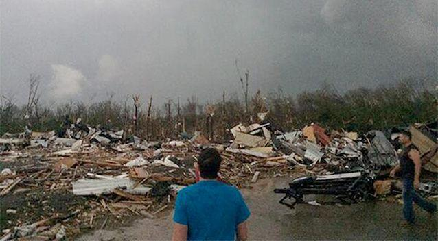 A powerful storm system rumbled through the central and southern United States on Sunday, spawning several tornadoes, including one that killed two people in a small northeastern Oklahoma city and another that carved a path of destruction through several northern suburbs of Little Rock, Arkansas. Photo: AP/James Bryant.
