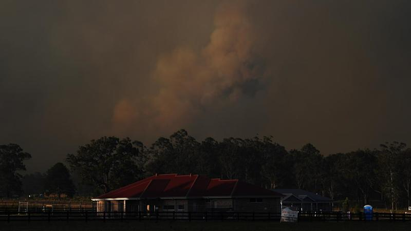 Firefighters have tried to save properties as residents around Taree wait in evacuation centres