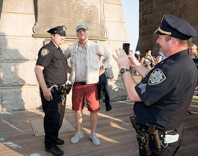 """<p>The <a href=""""https://www.yahoo.com/celebrity/tagged/bill-murray/"""" data-ylk=""""slk:man of the people"""" class=""""link rapid-noclick-resp"""">man of the people</a> walked across the Brooklyn Bridge during the annual Poets House Poetry Walk to raise money to keep the city's poetry library free and open to the public. Murray even mingled with some of New York City's finest during his appearance. (Photo: Mike Pont/Getty Images) </p>"""
