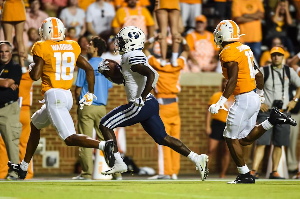 KNOXVILLE, TN - SEPTEMBER 7: Brigham Young Cougars running back Ty'Son Williams (5) runs the ball past Tennessee Volunteers defensive back Shawn Shamburger (12) and defensive back Nigel Warrior (18) for a touchdown during a college football game between the Tennessee Volunteers and Brigham Young Cougars on September 7, 2019, at Neyland Stadium in Knoxville, TN. (Photo by Bryan Lynn/Icon Sportswire via Getty Images)