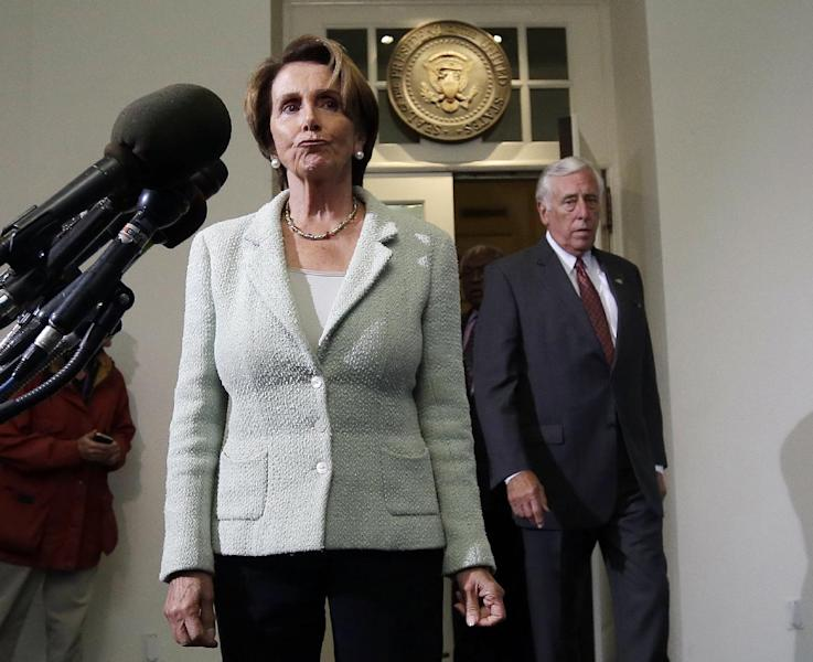 House Minority Leader Rep. Nancy Pelosi, D-Calif., left, and Minority Whip Steny Hoyer, D-Md., right, walk out of the West Wing of the White House to speak to members of the media following their meeting with President Barack Obama, Wednesday, Oct. 9, 2013, in Washington. (AP Photo/Pablo Martinez Monsivais)