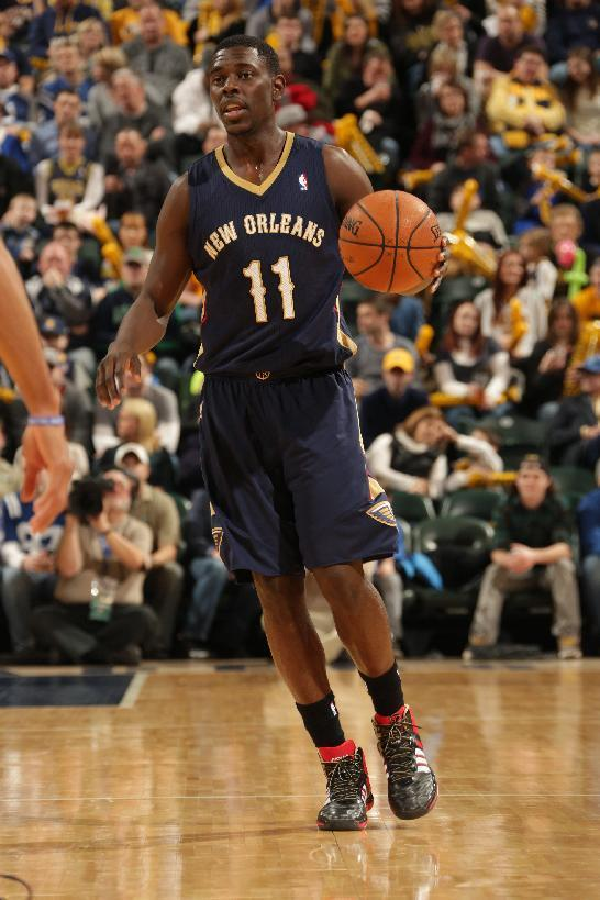 INDIANAPOLIS - JANUARY 4: Jrue Holiday #11 of the New Orleans Pelicans dribbles the ball against the Indiana Pacers at Bankers Life Fieldhouse on January 4, 2014 in Indianapolis, Indiana. (Photo by Ron Hoskins/NBAE via Getty Images)
