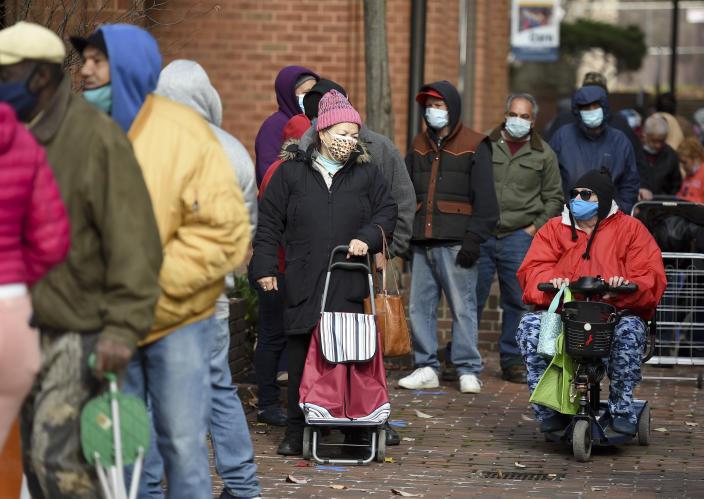 Reading, PA - November 23: People wait in line to get turkeys. During the distribution for the Annual Alvernia University Turkey Drive Monday morning November 23, 2020 at their new downtown College Towne Location on Penn Street in Reading. (Photo by Ben Hasty/MediaNews Group/Reading Eagle via Getty Images)