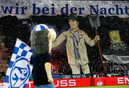 Soccer Football -DFB Cup - Schalke 04 vs Eintracht Frankfurt - Veltins-Arena, Gelsenkirchen, Germany - April 18, 2018 Schalke 04 fans display a banner before the match REUTERS/Wolfgang Rattay