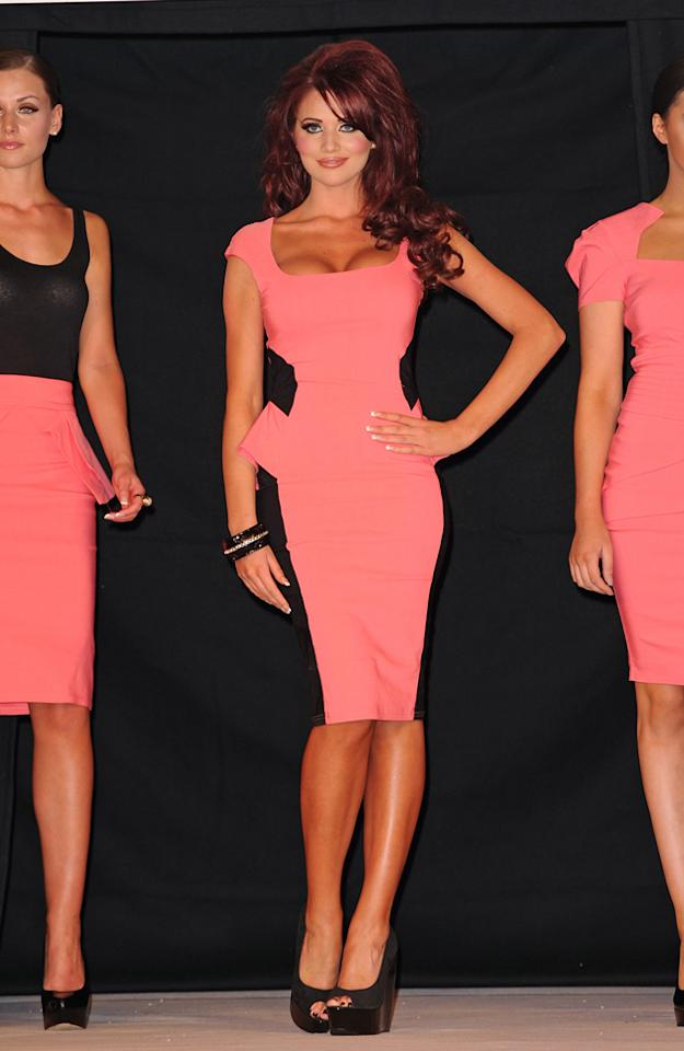 Celebrity fashion: Amy Childs launched her Spring/Summer 2012 clothing collection, including this summery pink and black optical illusion dress. We love the bright colour and can picture it with sky-high heels on a night out.