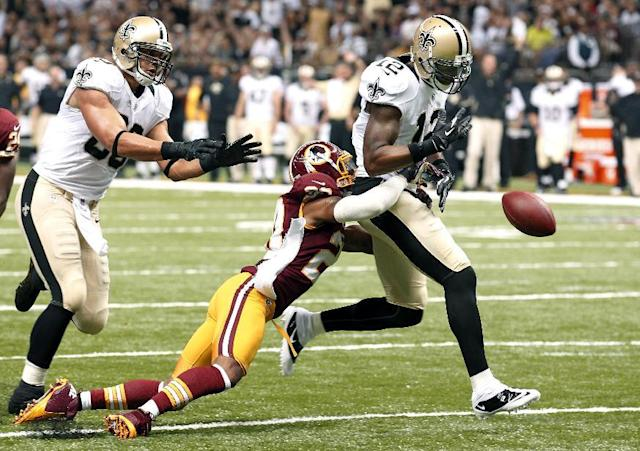 New Orleans Saints wide receiver Marques Colston (12) fumbles into the end zone, resulting in a touchback for the Washington Redskins, in the first half of an NFL football game at Mercedes-Benz Superdome in New Orleans, Sunday, Sept. 9, 2012. (AP Photo/Bill Haber)