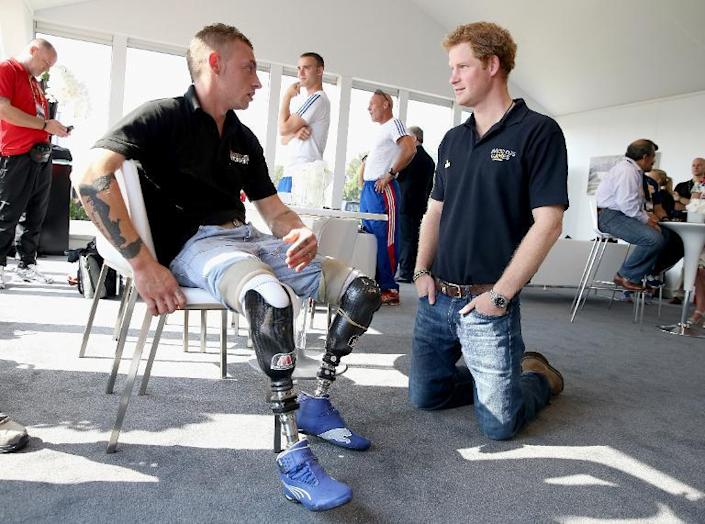 Prince Harry (right) speaks with David Birrell ahead of the Invictus Games, on September 9, 2014 (AFP Photo/Chris Jackson)