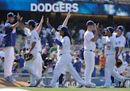"<p>L.A. Dodgers teammates Glenn Burke and Dusty Baker popularized the ""high five"" during a game against the Houston Astros on October 2, 1977. Needless to say, it caught on. </p>"
