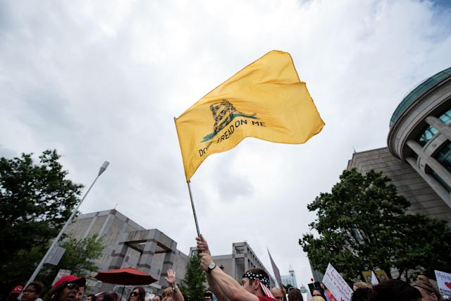 <p>A protester waves the flag 'Don't Dread on Me' during a North Carolina public school teacher march and rally in Raleigh, N.C., May 16, 2018. (Photo: Caitlin Penna/EPA-EFE/REX/Shutterstock) </p>