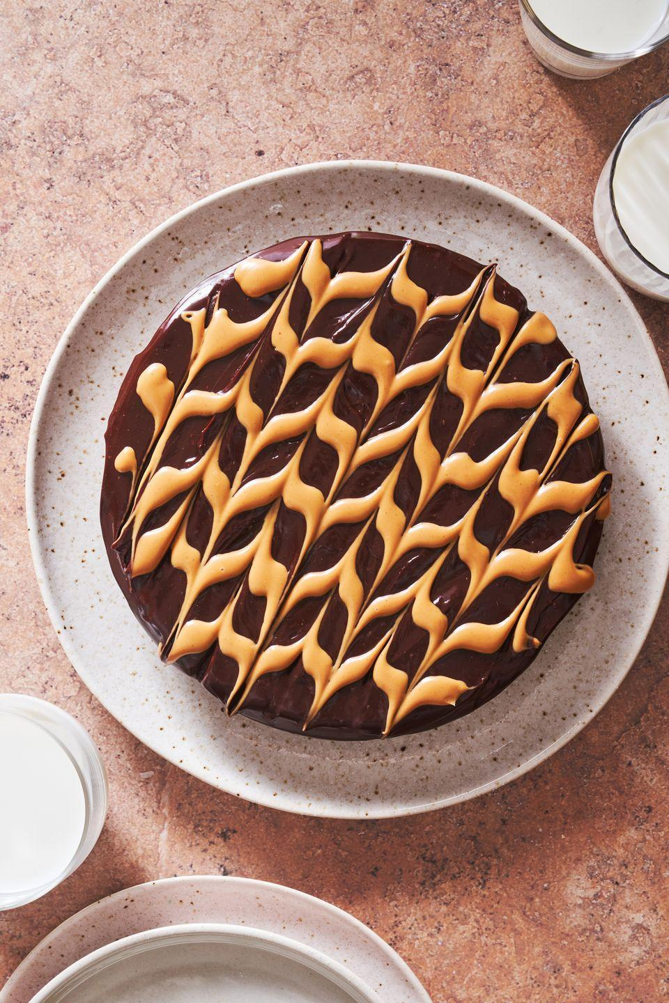 """<p>Trust us, heads will turn.</p><p>Get the recipe from <a href=""""https://www.delish.com/cooking/recipe-ideas/a36339267/flourless-peanut-butter-chocolate-cake-recipe/"""" rel=""""nofollow noopener"""" target=""""_blank"""" data-ylk=""""slk:Delish"""" class=""""link rapid-noclick-resp"""">Delish</a>.</p>"""