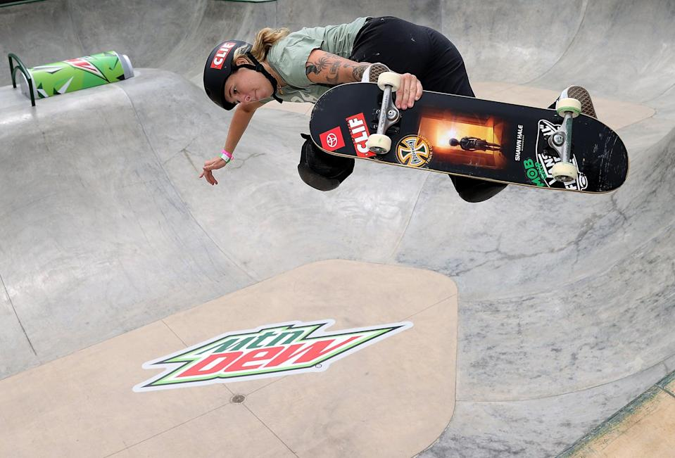 """<p>Especially in the past few years, Barratt has been getting on podium after podium for both skating and surfing. According to her <a href=""""http://usaskateboarding.com/blogs/2020-usa-skateboarding-national-team/jordyn-barratt-womens-park"""" class=""""link rapid-noclick-resp"""" rel=""""nofollow noopener"""" target=""""_blank"""" data-ylk=""""slk:USA Skateboarding profile"""">USA Skateboarding profile</a>, in 2017, she was the first female to qualify for the Dew Tour Park Am contest, skating alongside the men.</p> <p><strong>Olympic Team:</strong> Women's Skateboard Park</p> <p><strong>Age:</strong> 22<br></p> <p><strong>Hometown:</strong> Haleiwa, HI</p> <p><strong>Instagram:</strong> <a href=""""http://instagram.com/jordynbarratt"""" class=""""link rapid-noclick-resp"""" rel=""""nofollow noopener"""" target=""""_blank"""" data-ylk=""""slk:@jordynbarratt"""">@jordynbarratt</a></p>"""