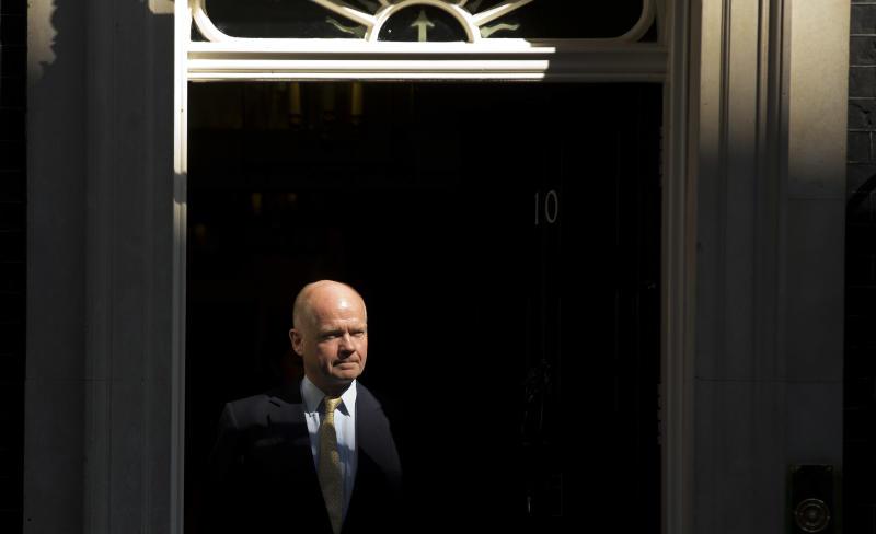 "British Foreign Secretary William Hague leaves 10 Downing Street in London, after attending a cabinet meeting on Syria, Thursday, Aug. 29, 2013. Britain's opposition Labour Party has indicated it may not support even a watered down version of a government resolution on Syria. Labour leader Ed Miliband said Thursday he is unwilling to give Prime Minister David Cameron a ""blank check"" for conducting possible future military operations against Syria. (AP Photo/Matt Dunham)"