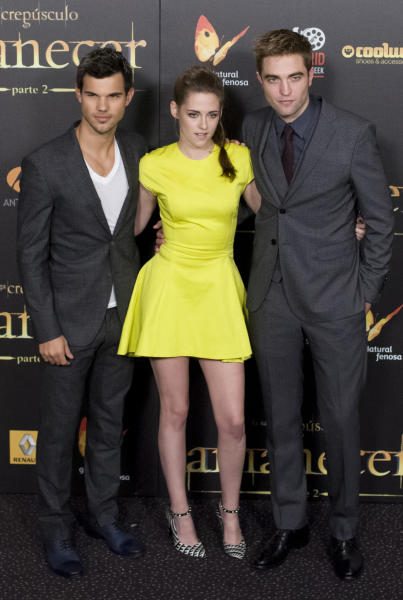 """FILE - In this Thursday, Nov. 15, 2012 file photo, from left, American actor Taylor Lautner, American actress Kristen Stewart and British actor Robert Pattinson pose during a photo call at the Spanish premiere of the film """"The Twilight Saga: Breaking Dawn-Part 2"""" in Kinepolis Cinema in Madrid, Spain. Stewart, Pattinson and Lautner have walked their last """"Twilight"""" red carpet with the arrival of the finale """"The Twilight Saga: Breaking Dawn - Part 2,"""" and now must step into careers of their own using the superstardom the multi-billion-dollar franchise has provided them. ( AP Photo/Gabriel Pecot, File)"""