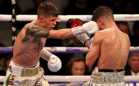 Charlie Edwards (L) punches Angel Moreno during the WBC World Flyweight Championship fight between Charlie Edwards and Angel Moreno at Copper Box Arena on March 23, 2019 in London, England - Credit: Getty Images