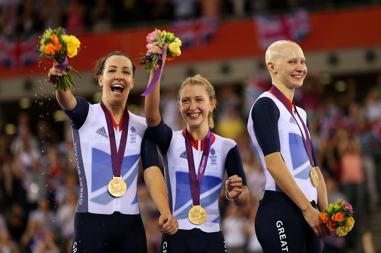 LONDON, ENGLAND - AUGUST 04:  (L-R) Dani King, Laura Trott, and Joanna Rowsell of Great Britain celebrate with their Gold medals during the medal ceremony for the Women's Team Pursuit Track Cycling Finals after breaking the World Record on Day 8 of the London 2012 Olympic Games at Velodrome on August 4, 2012 in London, England.  (Photo by Bryn Lennon/Getty Images)