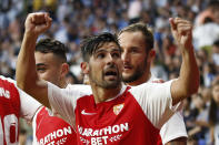 Sevilla's Nolito celebrates with team mates after scoring his side's second goal during the Spanish La Liga soccer match between Espanyol and Sevilla at the RCDE Stadium in Barcelona, Spain, Sunday Aug.18, 2019. (AP Photo/Joan Monfort)