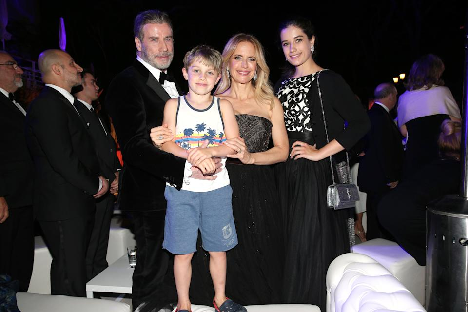 CAP D'ANTIBES, FRANCE - MAY 15: John Travolta and his wife Kelly Preston, daughter Ella Blue Travolta (R) and son Benjamin Travolta during the party in Honour of John Travolta's receipt of the Inaugural Variety Cinema Icon Award during the 71st annual Cannes Film Festival at Hotel du Cap-Eden-Roc on May 15, 2018 in Cap d'Antibes, France. (Photo by Gisela Schober/Getty Images)