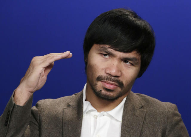 Manny Pacquiao says he wants to fight Floyd Mayweather and that it's not about the money. (AP)