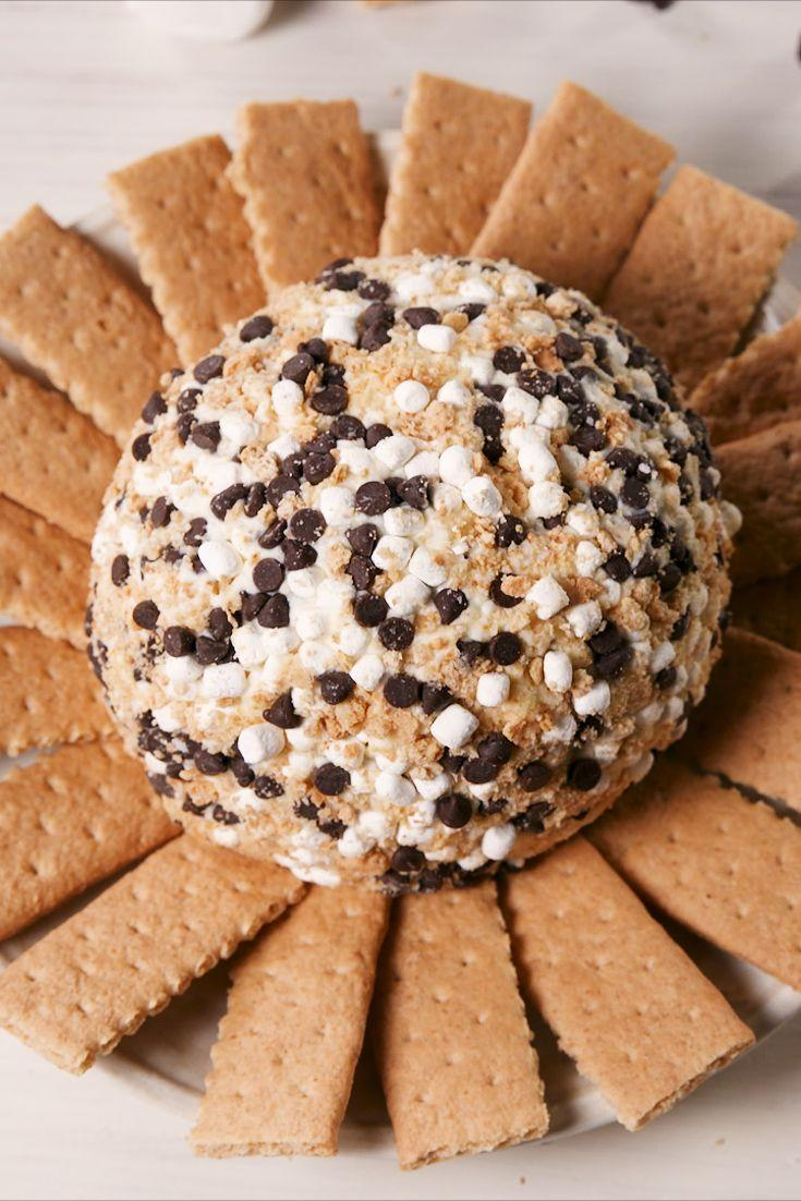 """<p>Camping dessert turned party app!</p><p>Get the recipe from <a href=""""https://www.delish.com/cooking/recipe-ideas/a21085339/smores-cheese-ball-recipe/"""" rel=""""nofollow noopener"""" target=""""_blank"""" data-ylk=""""slk:Delish."""" class=""""link rapid-noclick-resp"""">Delish.</a></p><p><strong><em><a class=""""link rapid-noclick-resp"""" href=""""https://www.amazon.com/dp/B00G3LRY3G?tag=syn-yahoo-20&ascsubtag=%5Bartid%7C1782.g.1631%5Bsrc%7Cyahoo-us"""" rel=""""nofollow noopener"""" target=""""_blank"""" data-ylk=""""slk:BUY NOW"""">BUY NOW</a> KitchenAid Hand Mixer, $40, amazon.com</em></strong></p>"""