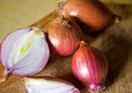 """<p><span class=""""redactor-unlink"""">In Greece, onions are hung on doors to</span> bring blessings in the coming year. The vegetable supposedly symbolizes growth and rebirth, and is also believed to cast away bad energy.</p>"""