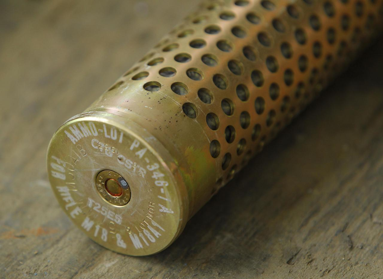 A 57mm caliber rifle cartridge is shown at the U.S. Army Letterkenny Munitions Center in Chambersburg, Pennsylvania November 19, 2012. Photo taken November 19, 2012. To match Special Report USA-PENTAGON/WASTE REUTERS/Gary Cameron (UNITED STATES - Tags: MILITARY POLITICS BUSINESS)