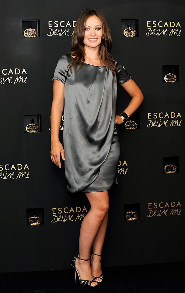 """Meanwhile in Madrid, """"House"""" hottie Olivia Wilde unveiled Escada's latest fragrance, """"Desire Me,"""" while sporting a stunning silk dress and fierce Jimmy Choo footwear. Carlos Alvarez/<a href=""""http://www.gettyimages.com/"""" target=""""new"""">GettyImages.com</a> - September 2, 2009"""