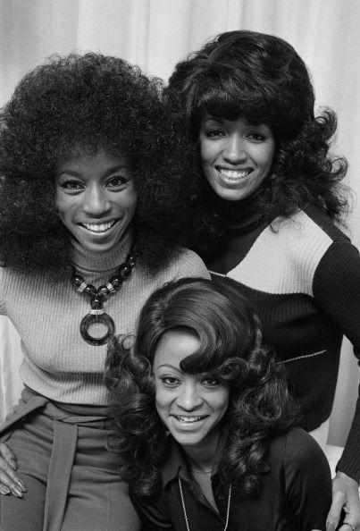 <p>The Three Degrees singers, Valerie Holiday, Helen Scott, and Freddie Pool, pose for a promotional photoshoot, while styling very different, but equally voluminous, looks. </p>